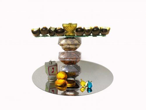 This has 3 tier nuts with a mirror tray and Belgium chocolates with candle chocolates
